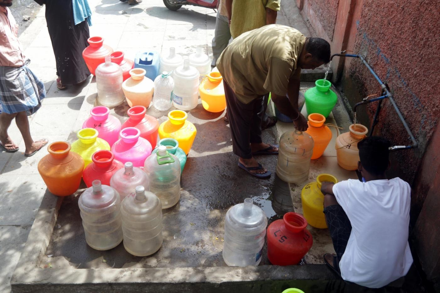 Chennai: Locals gather to collect drinking water at a water distribution point amid ongoing water crisis in Chennai, on June 19, 2019. Chennai and several other places in Tamil Nadu are going through water crisis. The reservoirs -- Cholavaram (full capacity 1,081 mcft) and Redhills (3,300 mcft) -- which cater to Chennai's water needs are dry while the storage at Poondi reservoir is 24 mcft as against the full capacity of 3,231 mcft, according to the Chennai Metropolitan Water Supply and Sewerage Board (Chennai Metro). (Photo: IANS) by .