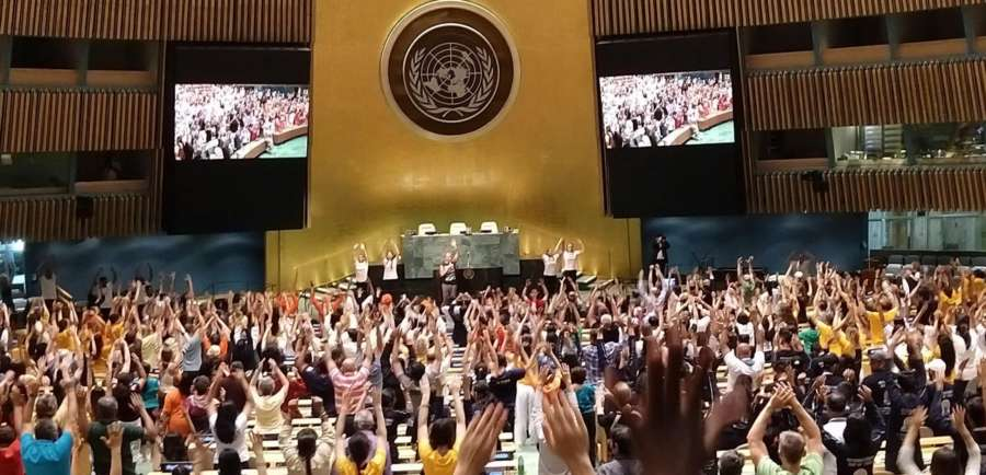 "Yoga Guru Kevin Tobar of the Bhakti Centre leads a session of ""office yoga"" at the United Nations General Assembly hall after rains forced the International Day of Yoga celebrations to move indoors. (Photo: Arul Louis/IANS) by ."
