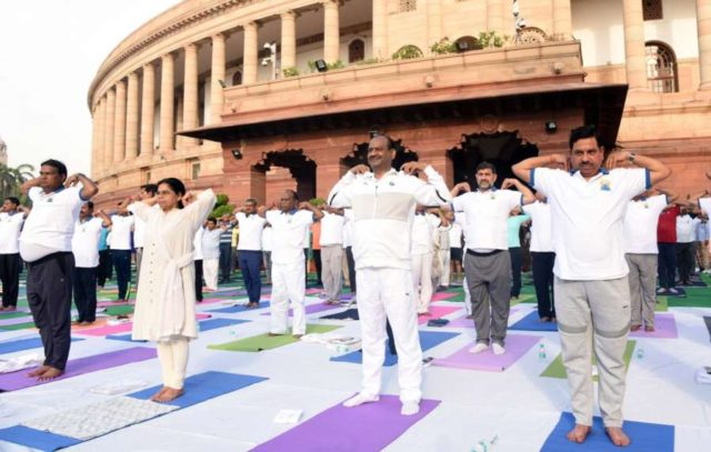 New Delhi: Lok Sabha Speaker Om Birla and BJP MP Bhupender Yadav practice yoga asanas -postures- on International Yoga Day 2019 at Parliament premises in New Delhi on June 21, 2019. (Photo: IANS) by .