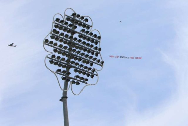 Leeds: A low flying airplane tows a large aerial banner reading