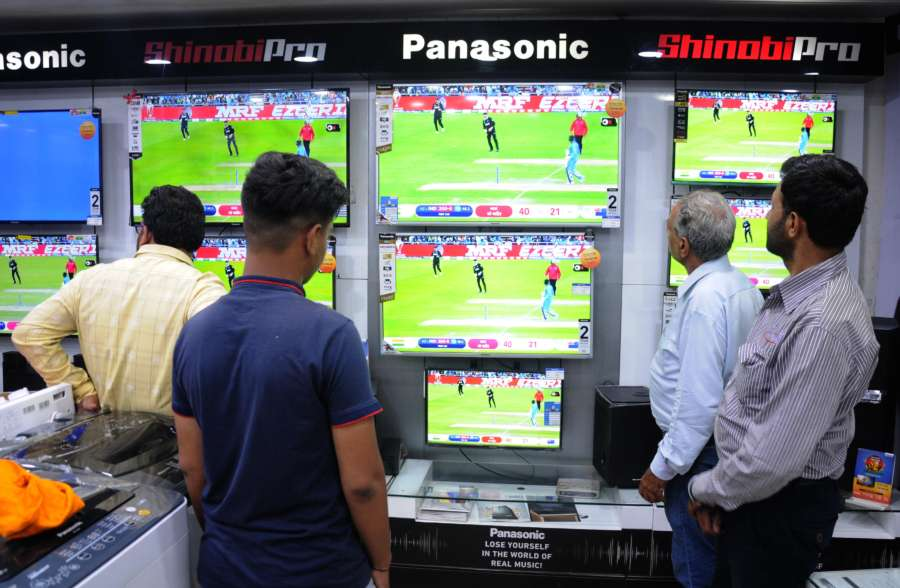 Amritsar: People busy watching the 1st Semi-final match of 2019 World Cup between India and New Zealand underway at Manchester's Old Trafford; at an electronics showroom in Amritsar on July 10, 2019. (Photo: IANS) by .