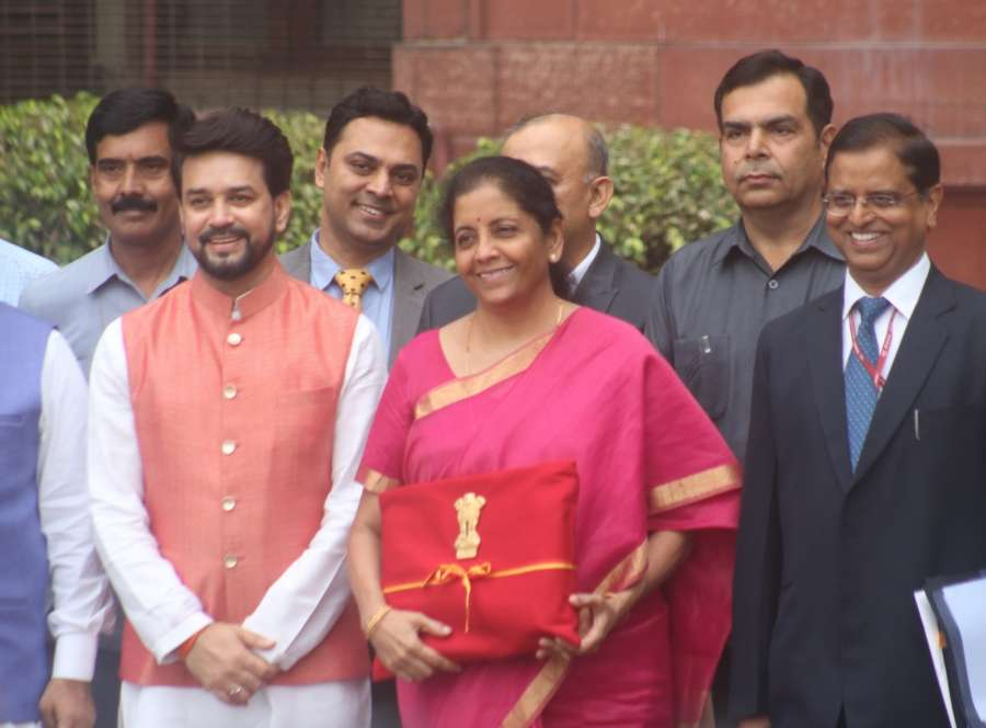 New Delhi: Union Finance Minister Nirmala Sitharaman along with Union Minister of State for Finance Anurag Thakur leaves for Rashtrapati Bhawan from North Block in New Delhi on July 5, 2019. (Photo: Bidesh Manna/IANS) by .