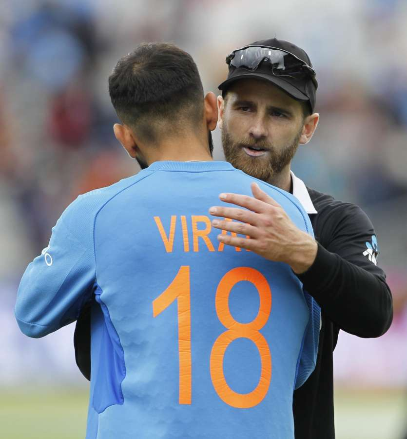 Manchester�: Indian skipper Virat Kohli congratulates New Zealand captain Kane Williamson after New Zealand won the 1st Semi-final match of 2019 World Cup against India at Old Trafford in Manchester, England on July 10, 2019. (Photo: Surjeet Kumar/IANS) by .