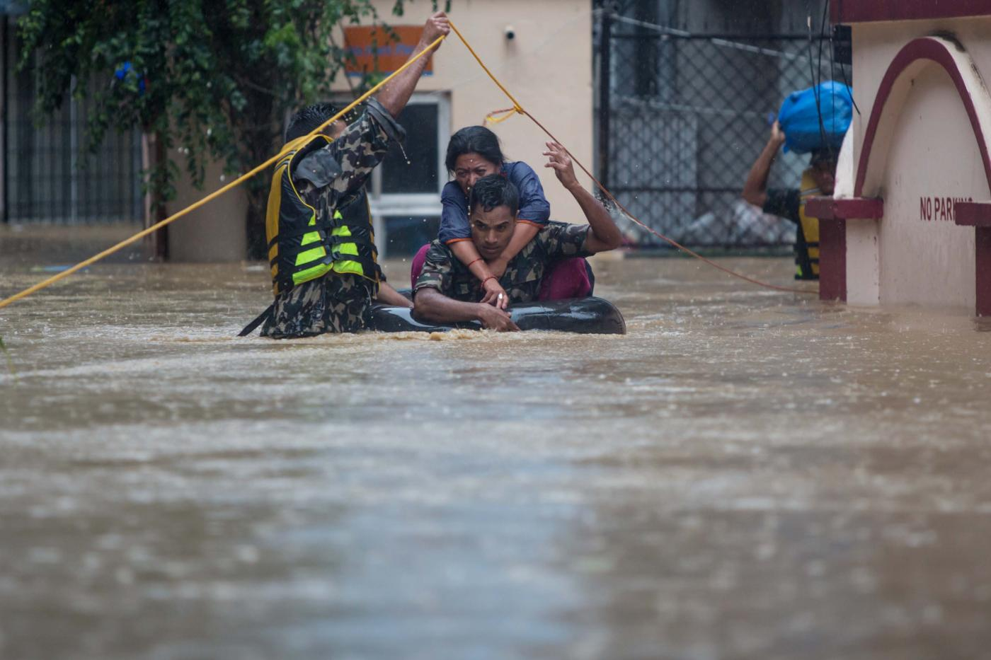 KATHMANDU, July 12, 2019 (Xinhua) -- Nepalese army personnel rescue local people after a heavy rainfall in Kathmandu, Nepal, July 12, 2019. Nepal was hit by heavy rainfall that caused floods and landslides in many places. (Xinhua/Sulav Shrestha/IANS) by sulav shrestha.