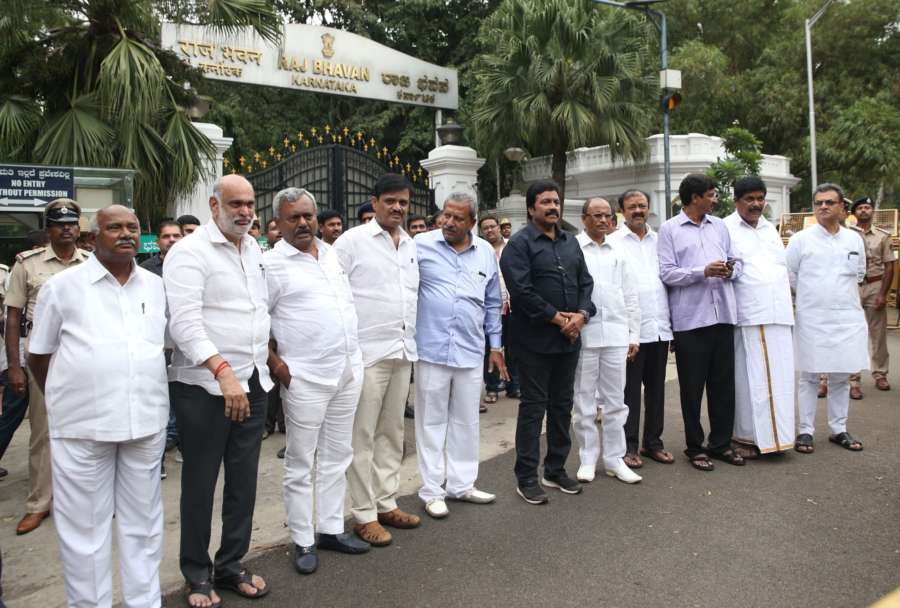 Bengaluru: Eight Congress and three Janata Dal-Secular (JD-S) legislators arrive at Raj Bhawan to submit their resignations to the Governor, in Bengaluru on July 6, 2019. (Photo: IANS) by .
