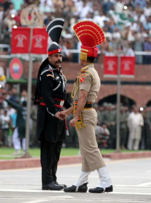 Attari: Beating Retreat ceremony underway at Attari-Wagha border on the eve of Independence Day in Attari near Amritsar on Aug 14, 2019. (Photo: IANS) by .