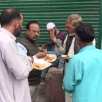 Shopian: National Security Advisor Ajit Doval spotted having lunch with local residents in Shopian, Jammu and Kashmir on Aug 7, 2019. (Photo: IANS) by .