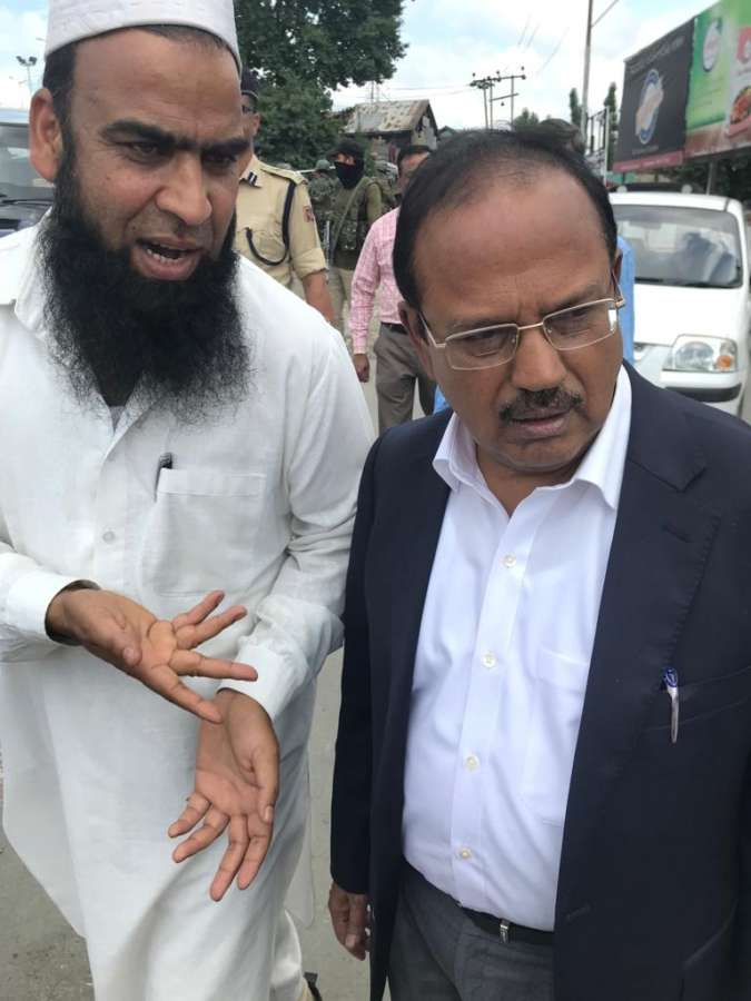 Anantnag: National Security Advisor (NSA) Ajit Doval interacts with public in Anantnag, Jammu and Kashmir on Aug, 10 2019. (Photo: IANS) by .