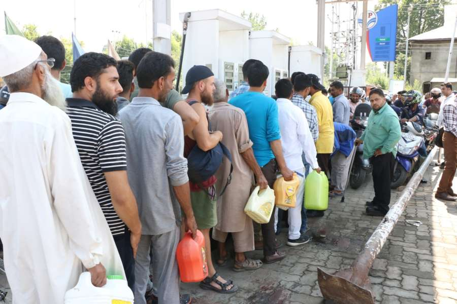 """Srinagar: A rush of people at a petrol pump in Srinagar on Aug 3, 2019. The state government in an advisory on Friday said, """"Keeping in view the latest intelligence inputs of terror threats, with specific targeting of the Amarnath Yatra, and given the prevailing security situation in the Kashmir Valley, in the interest of safety and security of the tourists and Amarnath Yatris, it is advised that they may curtail their stay in the Valley immediately and take necessary measures to return as soon as possible."""" (Photo: IANS) by ."""