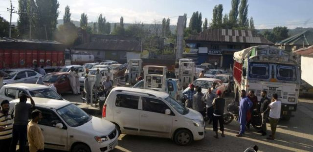 Baramulla: People queue up outside a petrol pump in Baramulla, Jammu and Kashmir on Aug 3, 2019. Most people in Jammu and Kashmir, especially in the Valley, believe that Article 35A of the Constitution is going amid reports that the idea of dividing the state into three union territories of Jammu, Valley and Ladakh is also being toyed with. (Photo: IANS) by .