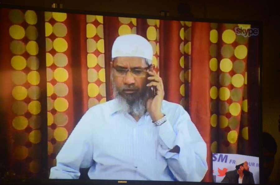 Mumbai: Controversial Islamic preacher Zakir Naik addresses a press conference through Skype in Mumbai, on July 15, 2016. (Photo: IANS) by .