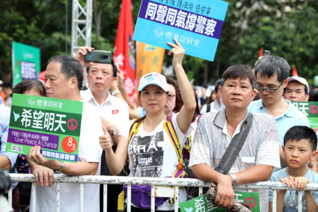 HONG KONG, Aug. 3, 2019 (Xinhua) -- People take part in a rally to denounce violence and support police force at Victoria Park in Hong Kong, south China, Aug. 3, 2019. Tens of thousands of Hong Kong residents gathered at a park on Saturday afternoon to express their strong opposition to violence and firm support to the police force. (Xinhua/Wu Xiaochu/IANS) by Wu Xiaochu.