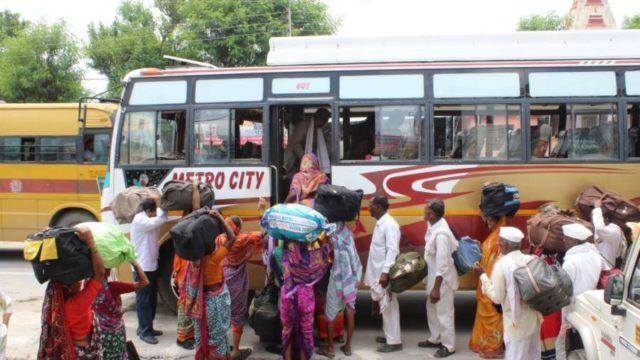 Jammu: Amarnath pilgrims board a bus from Bhagwati Nagar base camp as they leave for their respective homes after the Jammu and Kashmir Administration on Friday advised the tourists and yatris that