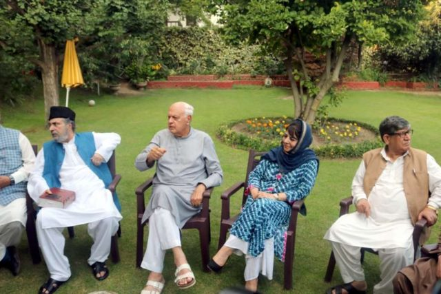 Srinagar: Peoples Democratic Party (PDP) leader Mehbooba Mufti and Nation Conference President Farooq Abdullah during All party meeting at Farooq Abdullah's residence in Srinagar on Aug 4, 2019. (Photo: IANS) by .
