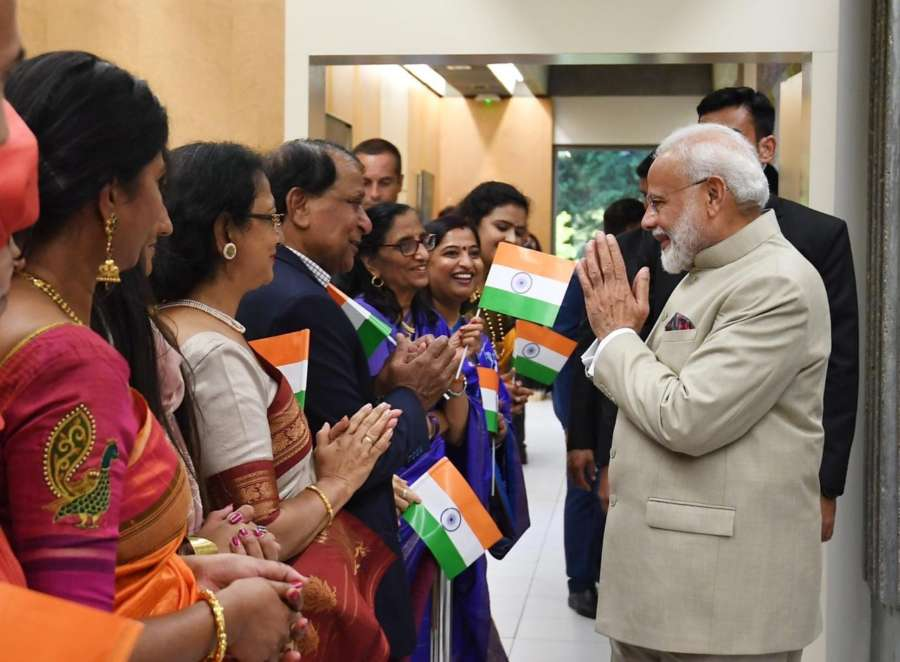 Paris: Prime Minister Narendra Modi being received by members of Indian community in Paris, France on Aug 22, 2019. (Photo: IANS/MEA) by .