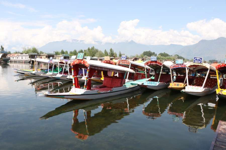 Srinagar: Shikaras anchored on the banks of Srinagar's Dal Lake as tourists leave Jammu and Kashmir after the Indian government advised Amarnath pilgrims and tourists to leave in view of the security situation. (Photo: IANS) by .