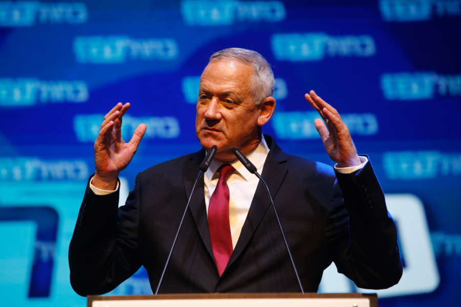 TEL AVIV, Sept. 18, 2019 (Xinhua) -- Blue and White party leader Benny Gantz gives a speech during a rally with supporters in Tel Aviv, Israel, Sept. 17, 2019. Israeli Prime Minister Benjamin Netanyahu's main challenger Benny Gantz said on Wednesday morning that it is too early to declare a victory in the country's parliamentary elections and called for a unity government. Initial exit polls posted by Israel's three main TV channels showed Gantz's centrist Blue and White party had a slight lead over Netanyahu's right-wing Likud party in Tuesday's vote, hurting Netanyahu's chances of winning a record-breaking fifth term. (Photo by Gil Cohen Magen/Xinhua/IANS) by guoyu.