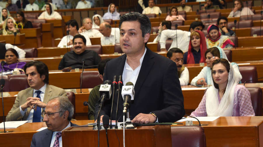 ISLAMABAD, June 11, 2019 (Xinhua) -- The photo released by Pakistan's Press Information Department (PID) on June 11, 2019 shows Pakistani Minister of Revenue Muhammad Hammad Azhar (front) presenting the federal budget for the fiscal year 2019-20 in Islamabad, capital of Pakistan. The Pakistani government on Tuesday proposed in its fresh budget to allocate 200 billion rupees (about 1.33 billion U.S. dollars) for the China-Pakistan Economic Corridor (CPEC) and relevant projects during the 2019-20 financial year starting July 1, 2019. (Xinhua/PID/IANS) by PID.