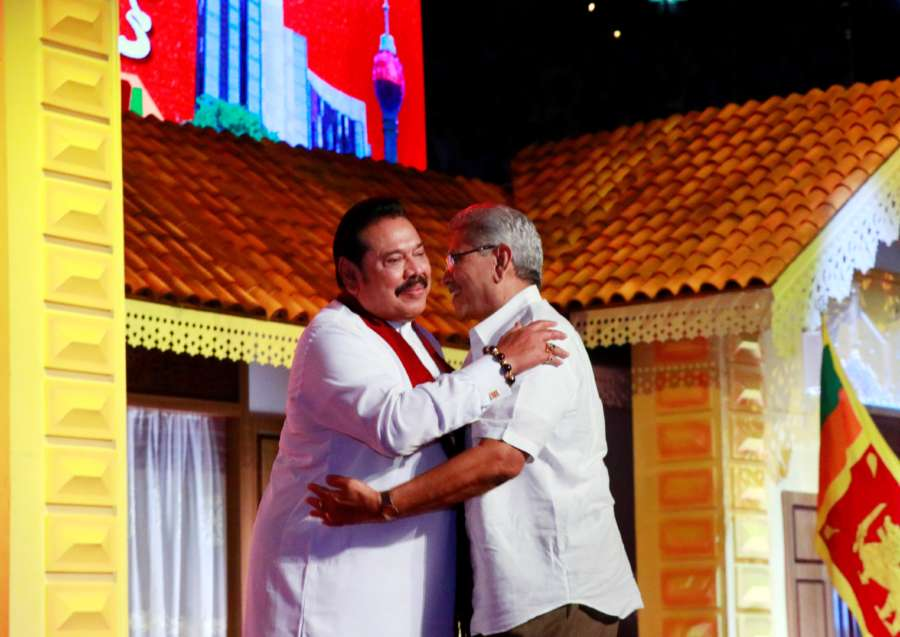 COLOMBO, Aug. 11, 2019 (Xinhua) -- Sri Lanka's opposition leader Mahinda Rajapaksa (L) hugs his brother, former defense secretary Gotabaya Rajapaksa, at a Sri Lanka Podujana Peramuna (SLPP) party conference held in Colombo, capital of Sri Lanka, Aug. 11, 2019. Sri Lanka's opposition leader Mahinda Rajapaksa on Sunday named his brother and former defense secretary Gotabaya Rajapaksa as the opposition's presidential candidate in a presidential race which will be held later this year. Sri Lankan President Maithripala Sirisena said recently that the Presidential Elections is likely to be held in November or December. (Photo by Ajith Perera/Xinhua/IANS) by Ajith Perera.