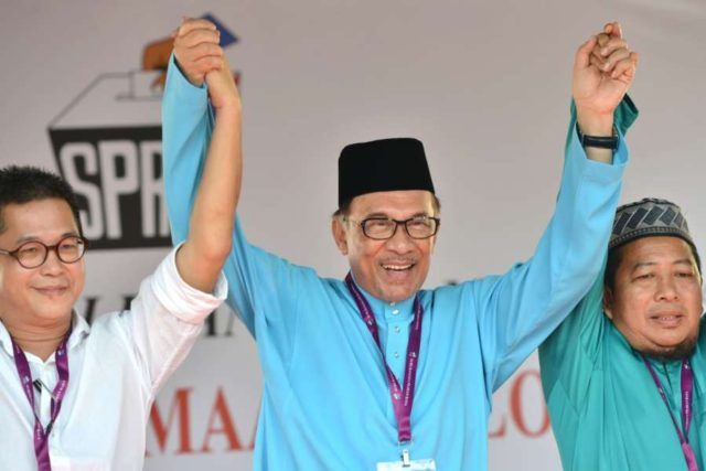 PORT DICKSON, Sept. 29, 2018 (Xinhua) -- Former Malaysian deputy Prime Minister Anwar Ibrahim (C) reacts after the nomination in Port Dickson, Malaysia, Sept. 29, 2018. Former Malaysian deputy Prime Minister Anwar Ibrahim is facing a multi-corner fight in a parliamentary seat, following the nomination of the by-election on Saturday. (Xinhua/Chong Voon Chung/IANS) by .