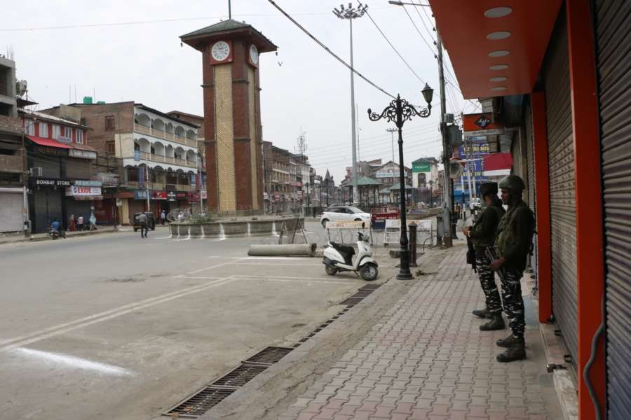Srinagar: Security beefed up as authorities imposed restrictions in parts of Srinagar city to prevent separatist called protests in connection with the Martyrs Day, on July 13, 2019. July 13 is observed as Martyrs Day in Jammu and Kashmir to remember those killed in the firing outside the Srinagar Central Jail by forces of the Dogra Maharaja in 1931. Shops, public transport and other businesses remained closed in Srinagar and many other towns in the Kashmir Valley. (Photo: IANS) by .