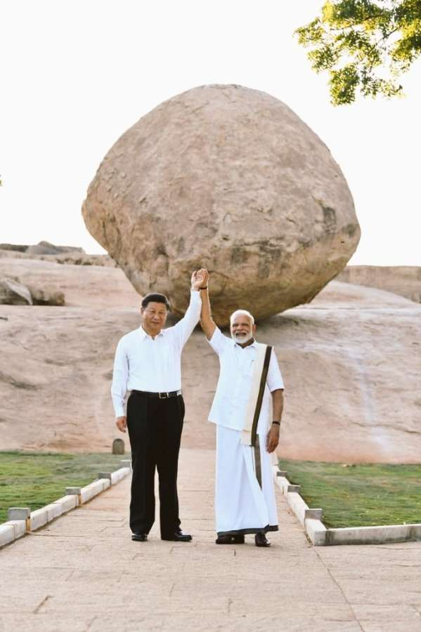 Mahabalipuram: Prime Minister Narendra Modi and Chinese President Xi Jinping during their visit to Krishna's butterball - a gigantic granite boulder sitting firmly on the slope of a hillock - in Mahabalipuram, Tamil Nadu on Oct 11, 2019. (Photo: IANS) by .