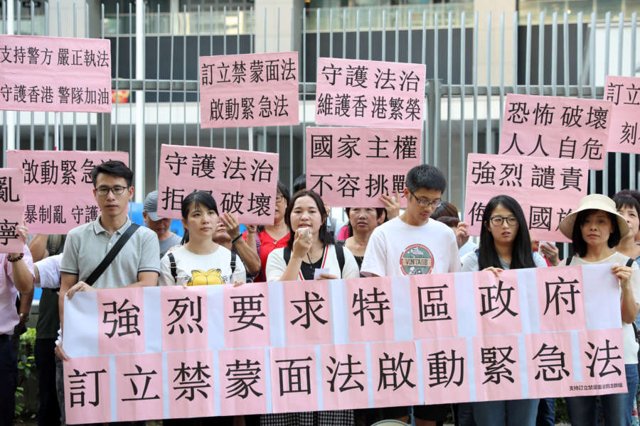 "HONG KONG, Oct. 4, 2019 (Xinhua) -- A civil group petitions for establishing the anti-mask law outside the Hong Kong Special Administrative Region government headquarters in Hong Kong, south China, Oct. 3, 2019. TO GO WITH ""Advocates call for anti-mask law in unrest-hit Hong Kong"" (Xinhua/Wu Xiaochu/IANS) by Wu Xiaochu."