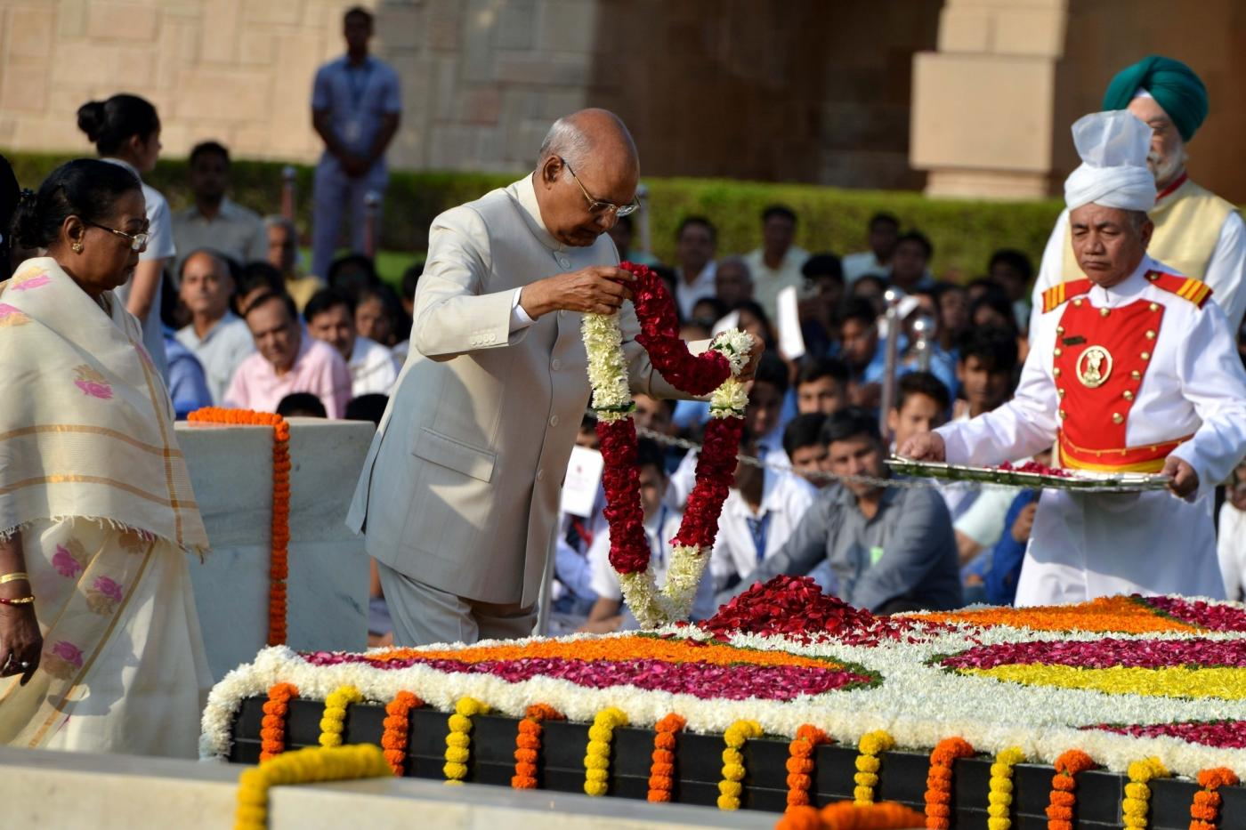 New Delhi: President of India Ram Nath Kovind paying tribute to Mahatma Gandhi on 150th birth Anniversary at Rajghat in New Delhi on Oct. 2, 2019. (Photo: IANS) by .