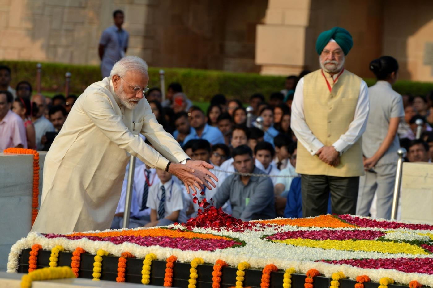 New Delhi: Prime minister Narendra Modi pays tribute to Mahatma Gandhi on his 150th birth Anniversary at Rajghat in New Delhi on Oct. 2, 2019. (Photo: IANS) by .