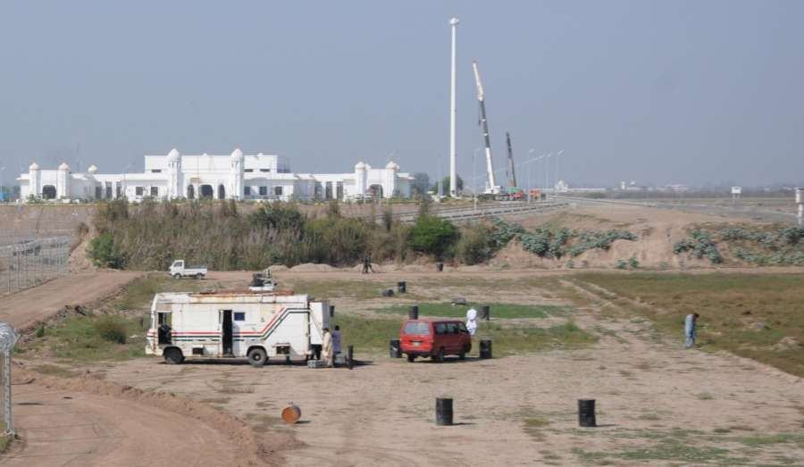Dera Baba Nanak: Construction work in progress at the Pakistani side of the International border for the Kartarpur Corridor, as seen from Zero Point near Dera Baba Nanak in Gurdaspur district of Punjab, India on Oct. 24, 2019. India and Pakistan on Thursday signed an agreement to operationalise the Kartarpur Corridor even as the ticklish issue of a $20 service fee imposed by Islamabad remained unresolved. (PhotO: IANS) by .