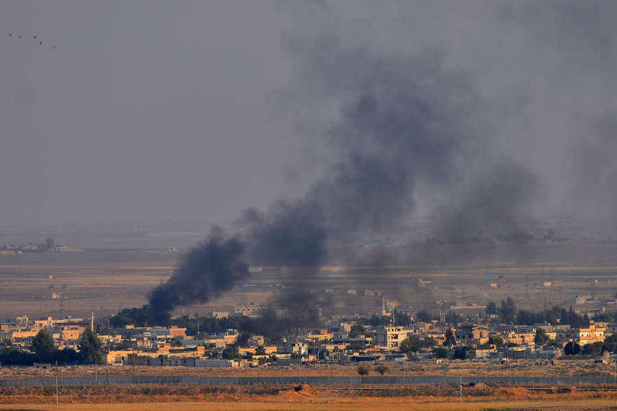 BEIJING, Oct. 23, 2019 (Xinhua) -- Photo taken from southern Turkish border town of Ceylanpinar on Oct. 10, 2019 shows smoke rising from the northern Syrian city of Ras al-Ain during an attack launched by Turkish army. (Photo by Mustafa Kaya/Xinhua/IANS) by Mustafa Kaya.