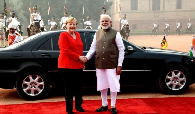 New Delhi: Prime Minister Narendra Modi welcomes German Chancellor Dr. Angela Merkel at the ceremonial reception organsied for her at Rashtrapati Bhavan in New Delhi on Nov 1, 2019. (Photo: IANS/PIB) by .