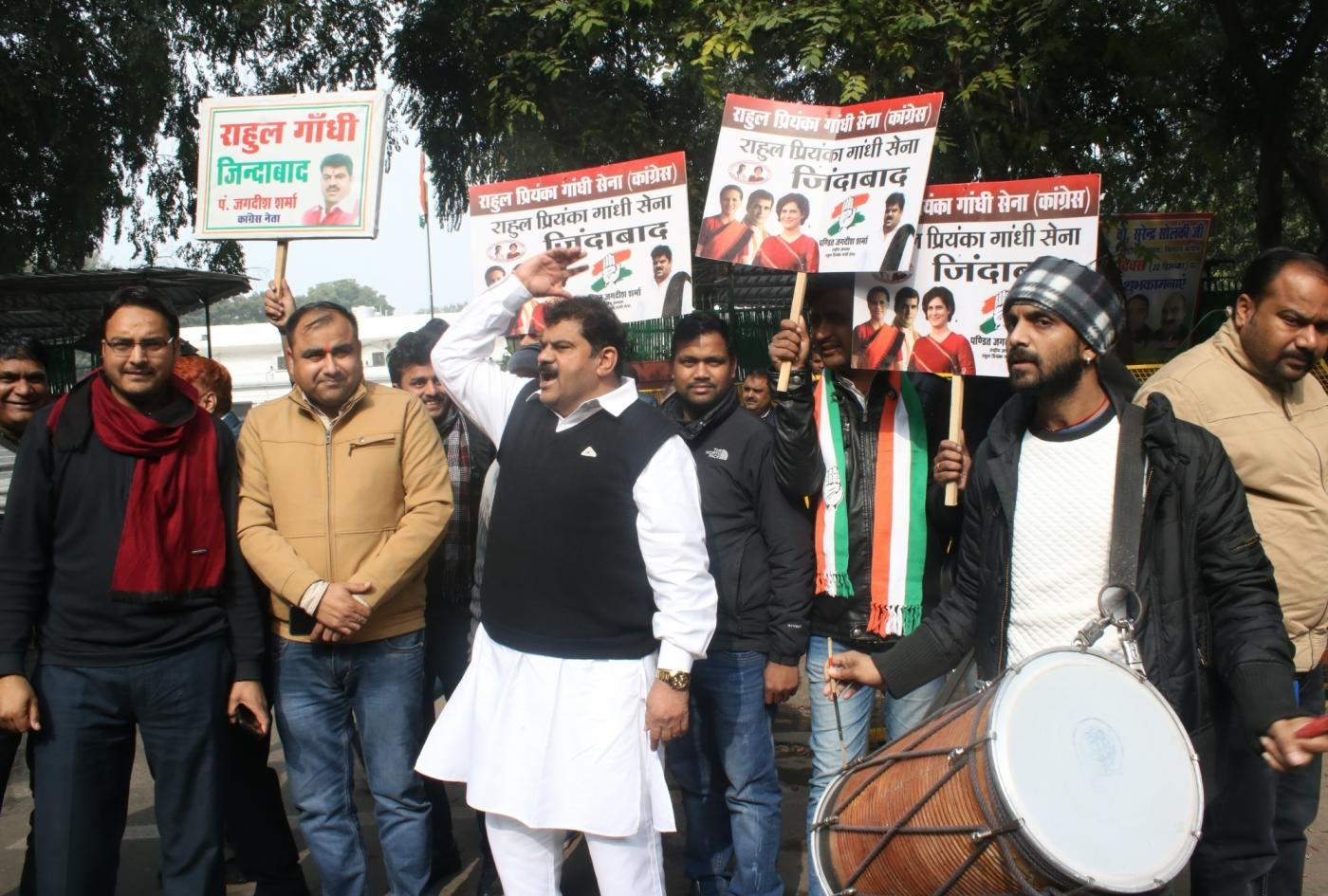 New Delhi: Congress workers celebrate the party's performance in Jharkhand Assembly elections as counting is underway, outside the party's headquarters in New Delhi on Dec 23, 2019. The grand alliance of the JMM-Cong-RJD has managed to take early lead over the BJP in Jharkhand Assembly elections as per the early trends and is likely to form the next government in the mineral rich state. (Photo: IANS) by .