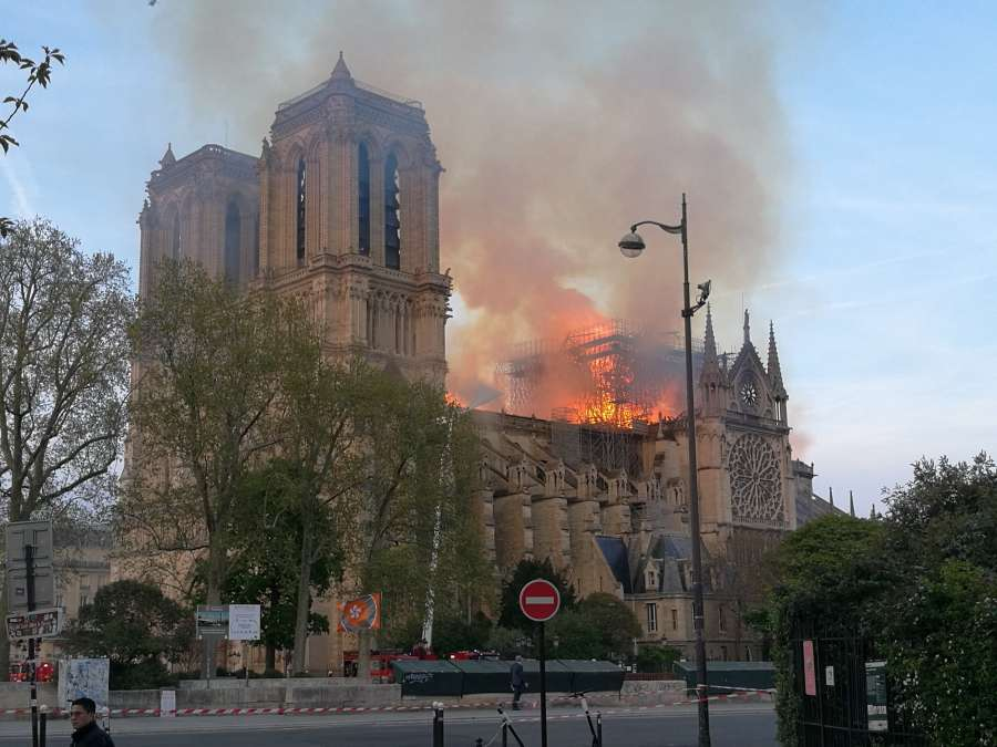 PARIS, April 15, 2019 (Xinhua) -- Flames and smoke rise from the Notre Dame Cathedral in central Paris, capital of France, on April 15, 2019. A blaze broke out on Monday afternoon at the Notre Dame Cathedral in central Paris where firefighters were still fighting to put the fire under control, Paris Mayor Anne Hidalgo said. (Xinhua/Xu Yongchun/IANS) by .