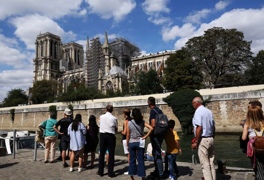 PARIS, Aug. 17, 2019 (Xinhua) -- People view the Notre Dame Cathedral under repairs in Paris, France, Aug.16, 2019. The Notre Dame Cathedral in central Paris caught fire on April 15 this year. (Xinhua/Gao Jing/IANS) by .