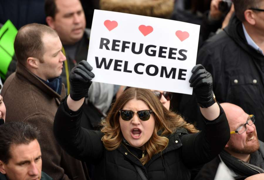 NEW YORK, Jan. 19, 2018 (Xinhua) -- File photo taken on Jan. 29, 2017 shows demonstrators participate in a protest against U.S. President Donald Trump's executive order temporarily barring all refugees and seven Mideast and North African countries' citizens from entry into the U.S. in front of the White House in Washington D.C., the Unite States. Protesters rallied in front of the White House on Sunday while demonstrations continued across more than 30 American airports after U.S. President Donald Trump signed an executive order temporarily barring all refugees and seven Mideast and North African countries' citizens from entry into the United States.Jan. 20, 2018 reaches one-year mark for Donald Trump as the 45th president of the United States. One year into U.S. President Donald Trump's presidency, the uncertainties and anxieties over his unconventional playbook appear to have not diminished. As he seeks to implement his campaign promises, which seem controversial and even unacceptable to many, rifts, feuds and controversies dogged the year and 2018 would probably not be any different. (Xinhua/Yin Bogu/IANS) by .