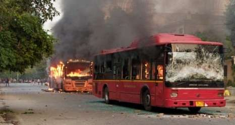 New Delhi: A bus set ablaze after a scuffle that broke out between the Delhi Police and Students of Jamia Millia Islamia in New Delhi on Dec 15, 2019. (Photo: IANS) by .