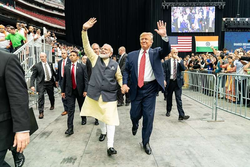 Prime Minister Narendra Modi and President Donald Trump stride around the Houston arena hand-in-hand on September 22, 2019, at the Howdy Modi event, a symbol of growing India-US ties. (Photo: White House/IANS). by .