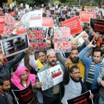 """New Delhi: Social activists stage a demonstration against the Citizenship Amendment Act (CAA) 2019 during """"#NotInMyName #repealcaa"""" protest rally, expressing solidarity with the students of Jamia Millia Islamia University who sustained injuries after they were lathi-charged by the police, in New Delhi on Dec 14, 2019. (Photo: IANS) by ."""
