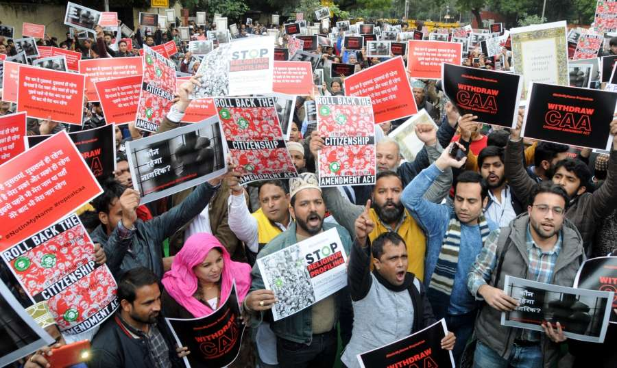 "New Delhi: Social activists stage a demonstration against the Citizenship Amendment Act (CAA) 2019 during ""#NotInMyName #repealcaa"" protest rally, expressing solidarity with the students of Jamia Millia Islamia University who sustained injuries after they were lathi-charged by the police, in New Delhi on Dec 14, 2019. (Photo: IANS) by ."