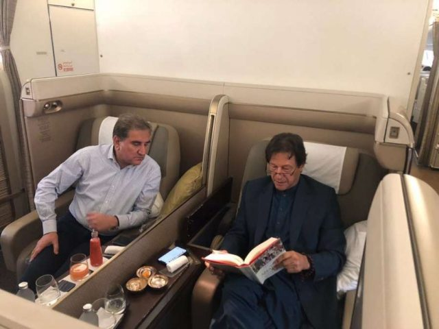 A photograph of Pakistan Prime Minister Imran Khan reading William Dalrymple's latest book 'The Anarchy' on his flight to Jeddah with Foreign Minister Shah Mahmood Qureshi peeking over from his seat has gone viral on social media. by .