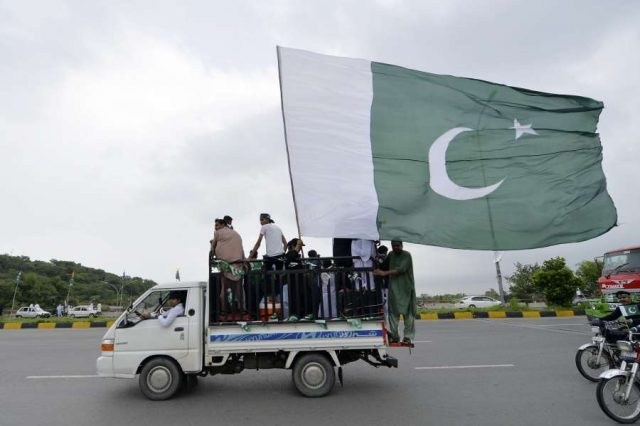 ISLAMABAD, Aug. 14, 2019 (Xinhua) -- A vehicle with Pakistan's national flag is seen on a street during the Independence Day celebrations in Islamabad, Pakistan, on Aug. 14, 2019. Pakistan got independence from the British colonial rule on Aug. 14, 1947. (Xinhua/Ahmad Kamal/IANS) by .