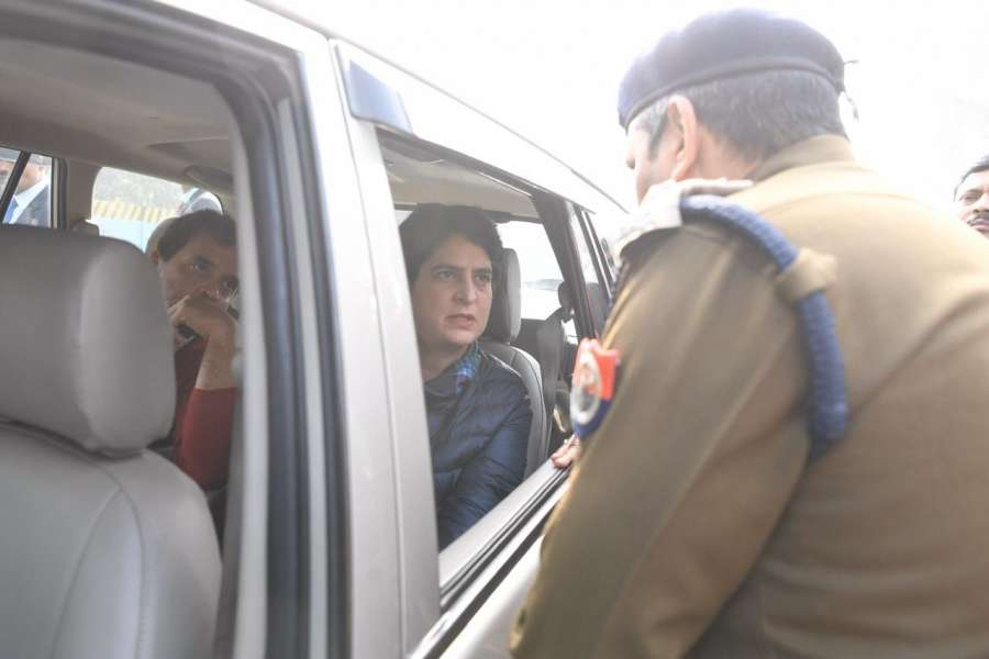New Delhi: Congress leaders Rahul Gandhi and Priyanka Gandhi Vadra being stopped by a police personnel as they arrive to meet the victims of alleged police firing during the violent demonstrations against the Citizenship Amendment Act (CAA) and the National Register of Citizens (NRC) last week, in Uttar Pradesh's Meerut on Dec 24, 2019. (Photo: IANS) by .