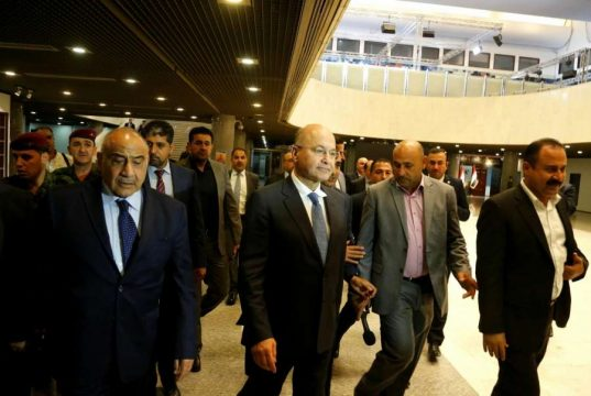 BAGHDAD, Oct. 2, 2018 (Xinhua) -- The newly-elected Iraqi President Barham Salih (2nd L, Front) and prime minister-designate Adel Abdul-Mahdi (1st L, Front) leave the parliament building in Baghdad, Iraq, on Oct. 2, 2018. The newly-elected Iraqi President Barham Salih on Tuesday named the Shiite independent politician Adel Abdul-Mahdi as prime minister-designate and tasked him with forming the next government, Iraq official television reported. (Xinhua/IANS) by .