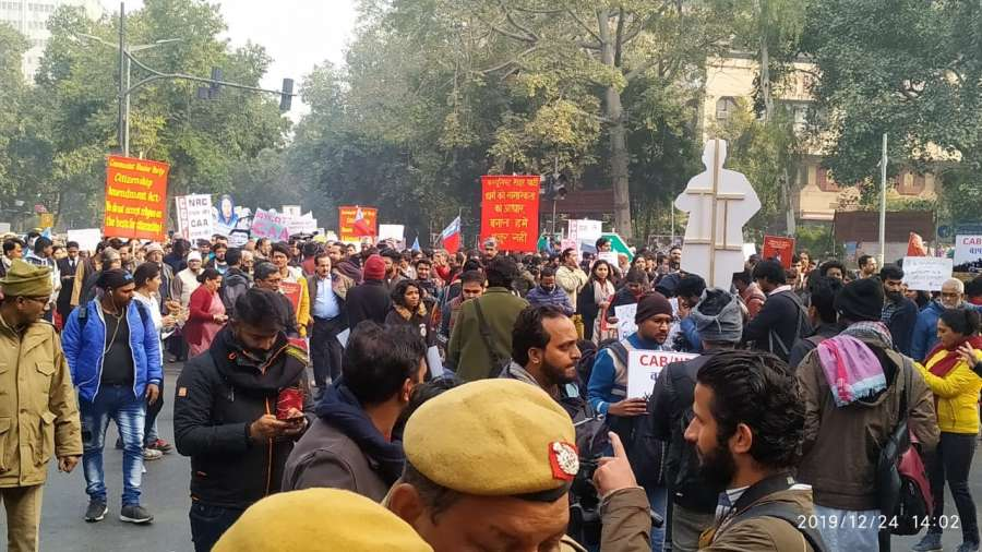 New Delhi: Despite prohibitory orders in place in the heart of the national capital, protesters gather in large numbers to protest against the Citizenship Amendment Act (CAA) 2019, amid tight security, at Mandi House in New Delhi on Dec 24, 2019. (Photo: IANS) by .