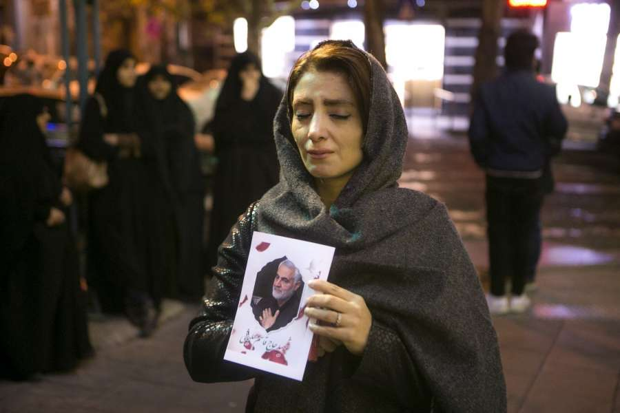 TEHRAN, Jan. 4, 2020 (Xinhua) -- A woman holds a poster of Qasem Soleimani, a top Iranian commander, during a mourning ceremony in Tehran, Iran, Jan. 3, 2020. An attack near Baghdad International Airport on Friday has killed Qasem Soleimani, and Abu Mahdi al-Muhamdis, the deputy top leader of Iraq's paramilitary Hashd Shaabi forces. (Photo by Ahmad Halabisaz/Xinhua/IANS) by .