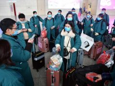 ZHENGZHOU, Jan. 26, 2020 (Xinhua) -- Members of a medical team gather at Zhengzhou East railway station in Zhengzhou, central China's Henan Province, on Jan. 26, 2020. A team comprised of 137 members from five medical institutions in Henan left Zhengzhou for Wuhan on Sunday to aid the coronavirus control efforts there. (Xinhua/Li Jianan/IANS) by .
