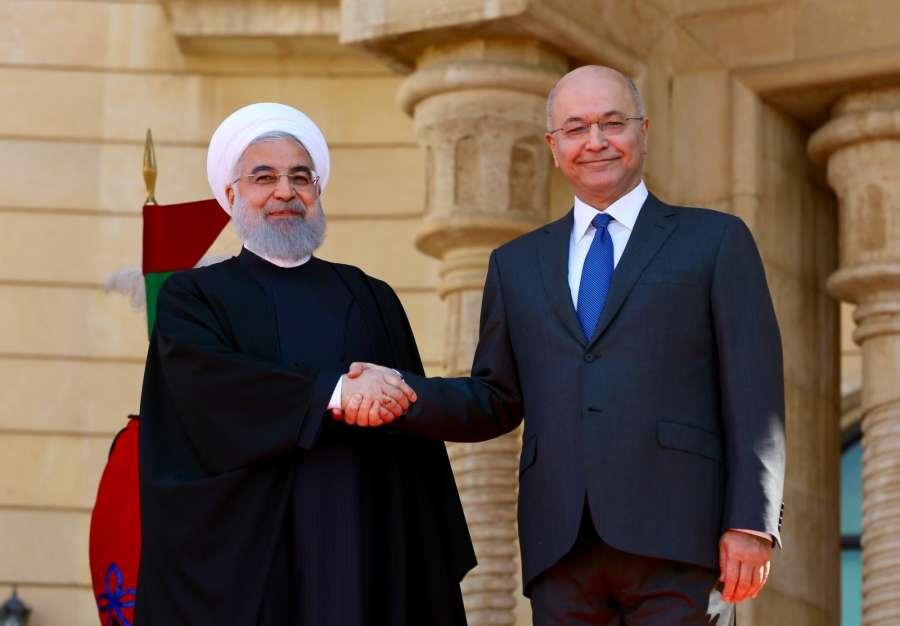 BAGHDAD, March 11, 2019 (Xinhua) -- Iraqi President Barham Salih (R) shakes hands with his Iranian counterpart Hassan Rouhani at the Presidential Palace in Baghdad, Iraq, March 11, 2019. Iranian President Hassan Rouhani arrived in Iraq's capital Baghdad Monday on an official visit aimed at boosting bilateral ties, the Iraqi official television reported. (Xinhua/Khalil Dawood/IANS) by .