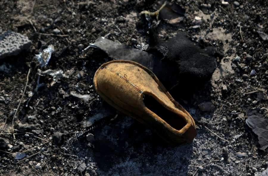 TEHRAN, Jan. 8, 2020 (Xinhua) -- A shoe is seen at the air crash site of a Boeing 737 Ukrainian passenger plane in Parand district, southern Tehran, Iran, on Jan. 8, 2020. All the 179 passengers and crew members on board the Boeing 737 Ukrainian passenger plane that crashed near Tehran Imam Khomeini International Airport (IKA) on Wednesday morning were confirmed dead, Iran's Press TV reported. (Photo by Ahmad Halabisaz/Xinhua/IANS) by .