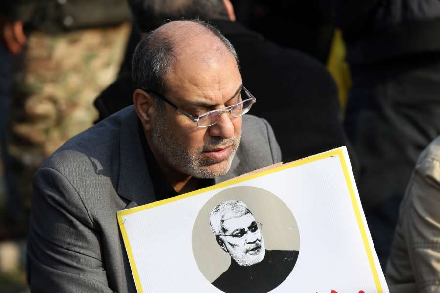 BAGHDAD, Jan. 4, 2020 (Xinhua) -- A mourner holds a picture of Abu Mahdi al-Muhandis, deputy chief of Iraq's paramilitary Hashd Shaabi forces, in Baghdad, Iraq, Jan. 4, 2020. Thousands of mourners on Saturday participated in a funeral of Qasem Soleimani, a senior Iranian commander, and Abu Mahdi al-Muhandis, deputy chief of Iraq's paramilitary Hashd Shaabi forces, who were killed in an U.S. airstrike in Iraq's capital Baghdad. (Xinhua/Khalil Dawood/IANS) by .